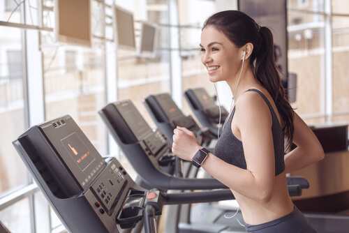 woman working out in hotel gym